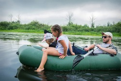 In the summer on a hot day in the inflatable rubber boat dad sai
