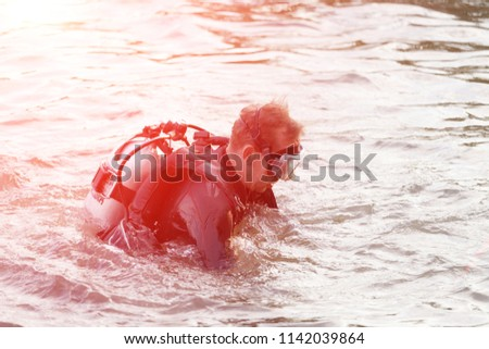 in the water a diver with an aqualung #1142039864