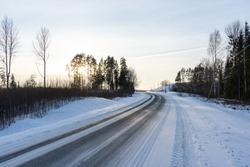 in the winter cold sunset black asphalt looks frozen