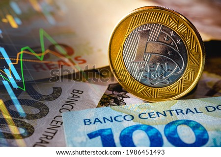 In this photo illustration being displayed fifty, one hundred and two hundred reais bills and a one reais coin highlighted. The Real is the current money in Brazil Foto stock ©