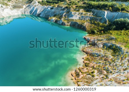 Inactive gypsum quarry. In the quarry is a lake with blue water. #1260000319