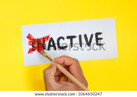 inactive is active concept. Hand with brush and card with word inactive