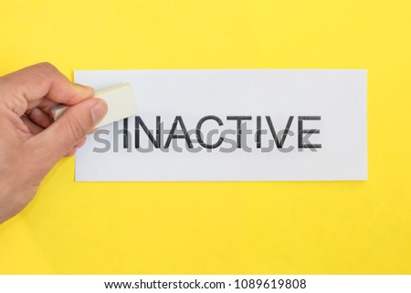 inactive is active concept. Hand with Eraser and card with word inactive