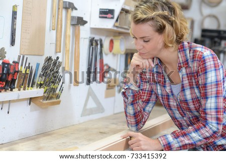 Inactive woman sat at workbench