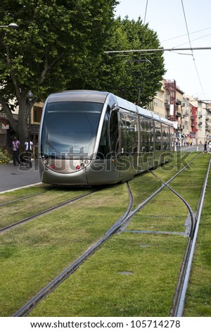 Inbound tram going down Boulevard Jean Jaures on a sunny day.