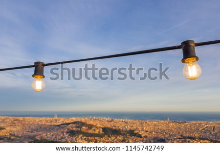 Incandescent bulbs on the observation deck on Tibidabo hill, Barcelona, Spain. Selective focus.