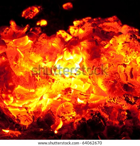 incandescent embers on the black background