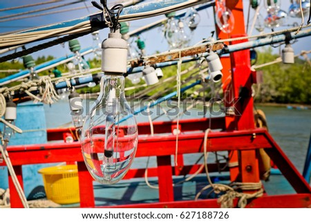 Shutterstock Incandescent lamp for catching squid.Bulbs for fishing on the fishing boat.Squid fishing boat light bulb, this is used at night to attract the animals at the water surface.