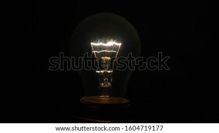 Incandescent lamp. Incandescent lamp in the dark