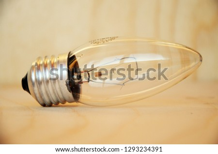 Incandescent lamp on a wood background