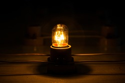 Incandescent lamps are screwed to the shades and the shades are connected with wires in the network and the lamps glow with yellow light.