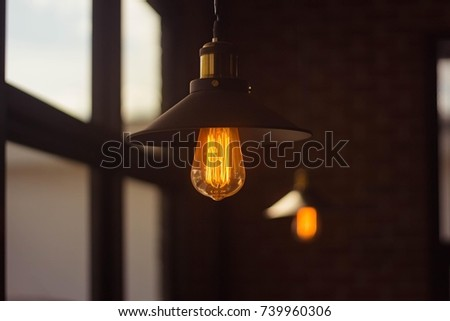 Incandescent lamps in a coffee shop. Edison lamp.