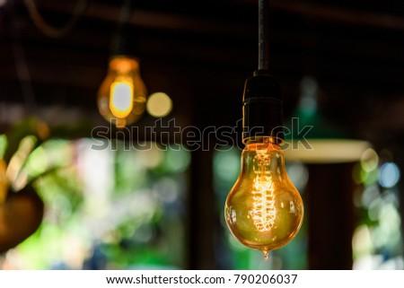 Incandescent lamps in wooden room. Edison lamp.