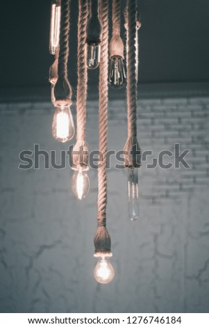 incandescent lamps on the harness hanging on the ceiling