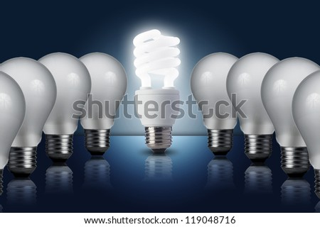 Incandescent light bulb in a row with middle fluorescent light bulb on. Concept for energy conservation