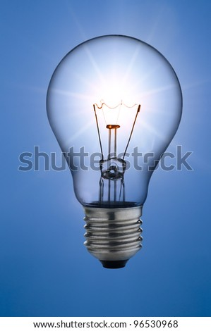 incandescent light bulb, on sunny skies background