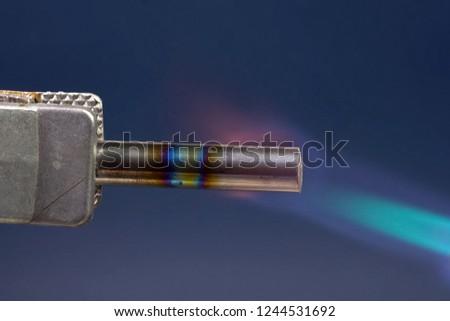 Incandescent tungsten rod gas burner. Incandescent tungsten rod gas burner.