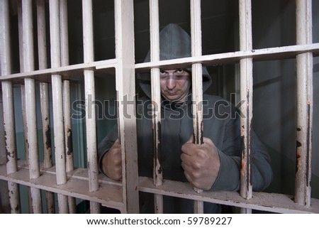 Incarcerated Inmate in a Cell - stock photo