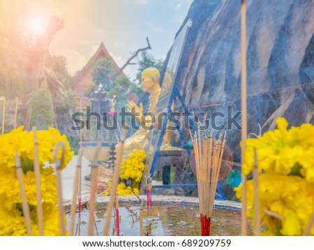 Incense at the altar to worship Buddha and Buddhist monks and lens flare. Buddhist Holy Day occur day of waxing and waning moon. Monk listen Patimok recitation. Kind of merits keep precepts in temple. - Shutterstock ID 689209759
