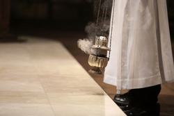 Incense during Mass at the altar and empty space for text