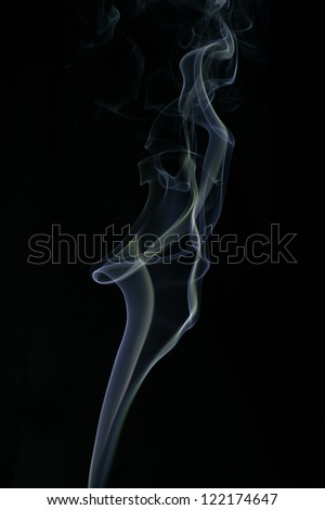 Incense smoke on black background