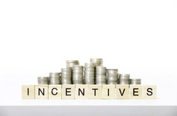 INCENTIVES text made with wood blocks.Business Concept