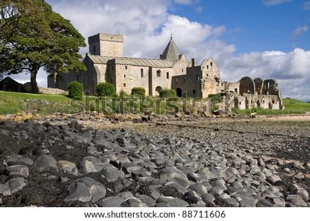 Inchcolm Abbey on the island of Inchcolm in the Firth of Forth near Edinburgh in Scotland. This picturesque ruin was founded in the 12th century and abandoned after the Scottish Reformation in 1560.