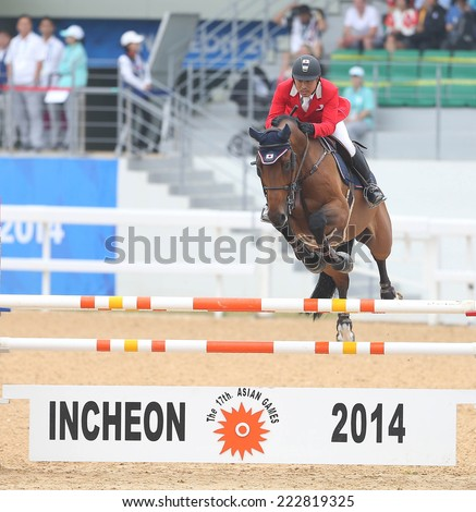 INCHEON - SEP 28: HIRAO Satoshi of Japan in action during the 2014 Incheon Asian Games at Dream Park Equestrian Venue on September 28, 2014 in Incheon, South Korea.