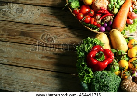 Include fresh organic vegetables in basket on wooden floor with copy space still life #454491715
