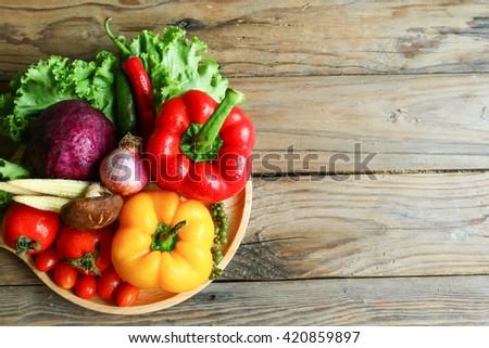 Include vegetables on wooden floor #420859897