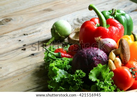 Include vegetables on wooden floor #421516945