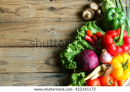 Include vegetables on wooden floor #422265172