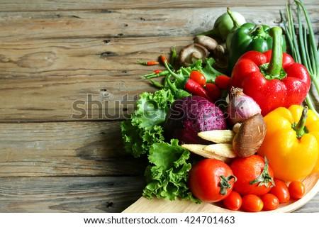Include vegetables on wooden floor #424701463