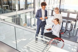 Inclusion and diversity in the business office with a businesswoman in a wheelchair