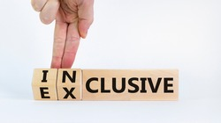 Inclusive or exclusive symbol. Businessman turns wooden cubes and changes words 'exclusive' to 'inclusive'. Beautiful white background, copy space. Business and inclusive or exclusive concept.