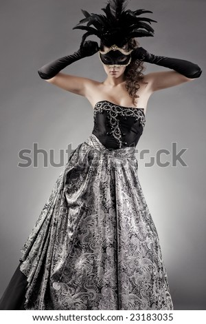 masquerade evening dress in ancient style and mask - stock photo