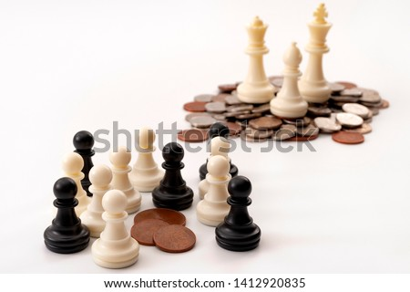 Income inequality and social issue concept theme with large group of chess pawns representing the poor and the middle class splitting a significantly smaller amount of money that a small group of rich Zdjęcia stock ©