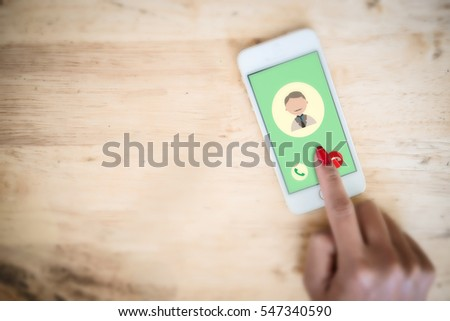 Incoming call from dad in a mobile phone. Woman touching on mobile screen. #547340590