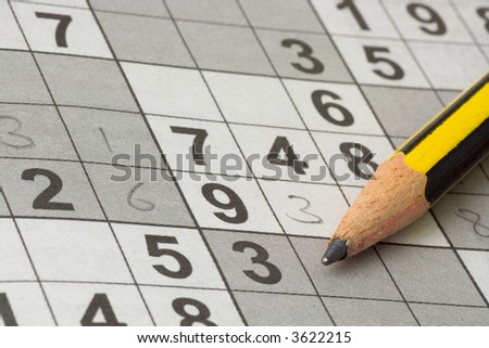 Incomplete Sudoku puzzle with a pencil