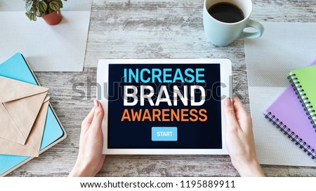 Increase brand awareness text on screen. Advertising and marketing concept.