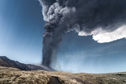 Incredible and frightening eruptive event of the Etna volcano, huge column of smoke in the sky. Catania - Sicily