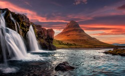 Incredible Nature landscape of Iceland. Fantastic picturesque sunset over Majestic Kirkjufell mountain and waterfalls. Church mountain, Iceland. Iceland the most beautiful and best travel place.