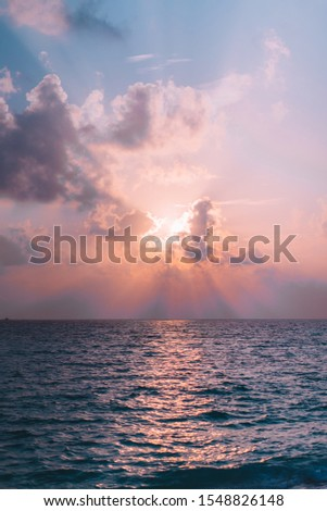 Incredible ocean sunset in the Maldives. This photo was taken during the last moment of the sunset. The beautiful colors reflect in the sky.  #1548826148