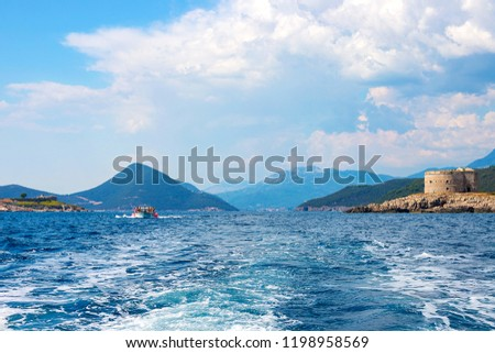 Incredible seascape. Old tower on a rocky shore by the sea, Boka-Kotor Bay, Montenegro #1198958569
