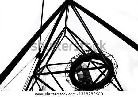 Incredible structure of the Tetrahedron in Bottrop, Germany captured on black and white picture taken from below in different perspective. The popular local landmark serves as a view point.
