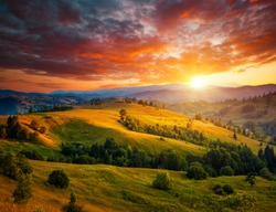 Incredible summer sunset in a mountain valley. Location place of Carpathian mountains, Ukraine, Europe. Vibrant photo wallpaper. Breathtaking nature photography. Discover the beauty of earth.