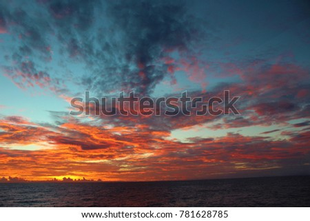 Incredible sunrise at sea in the Pacific Ocean #781628785