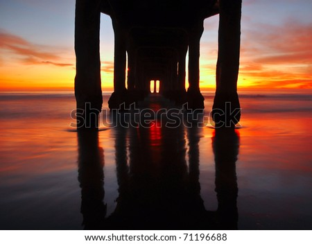 Incredible sunset with reflection of the Manhattan Beach pier, Los Angeles, California.
