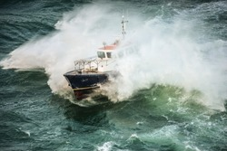incredible view of a pilot boat in the storm
