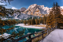 Incredible view on majestic famouse lake Braies in autumn season. Wonderful sunny landscape in dolomites Alps with perfect blue sky. Amazing nature Scenery. Lake Braies is also known as Lago di Braies